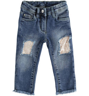 Pantalone in denim con toppe di paillettes